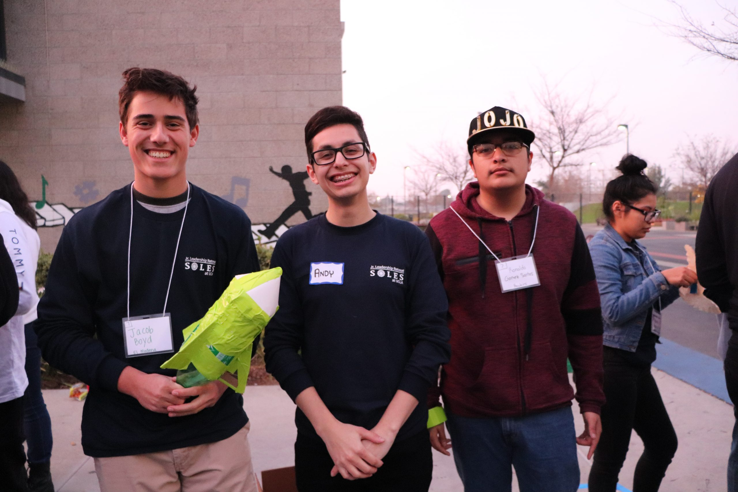 SOLES member Andy Muratalla poses with SHPE Jr. chapter members during Leadershpe Junior event.